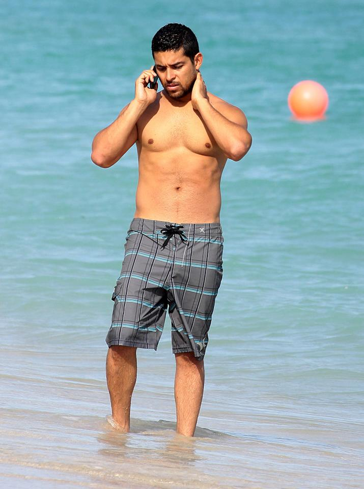 Actor Wilmer Valderrama enjoys a sunny beach day in Miami Beach with a mystery woman.