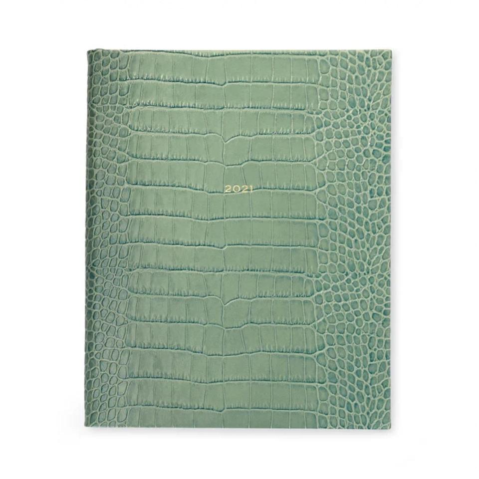 "Anyone looking to invest in a truly unique option for 2021 should consider this crocodile-embossed leather notebook from Smythson. The artisan print and sea green dye is brushed by hand, which gives it a distinctive depth of color and a price point that will ensure you don't let it collect dust in the drawer. $355, Smythson. <a href=""https://www.smythson.com/us/sea-green-2021-mara-portobello-agenda-with-pocket-1027287.html"" rel=""nofollow noopener"" target=""_blank"" data-ylk=""slk:Get it now!"" class=""link rapid-noclick-resp"">Get it now!</a>"