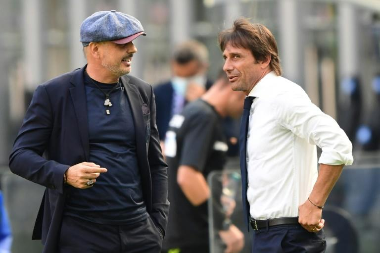 Bologna coach Sinisa Mihajlovic (L) talks with Inter Milan's Antonio Conte before a Serie A match behind closed doors in the San Siro