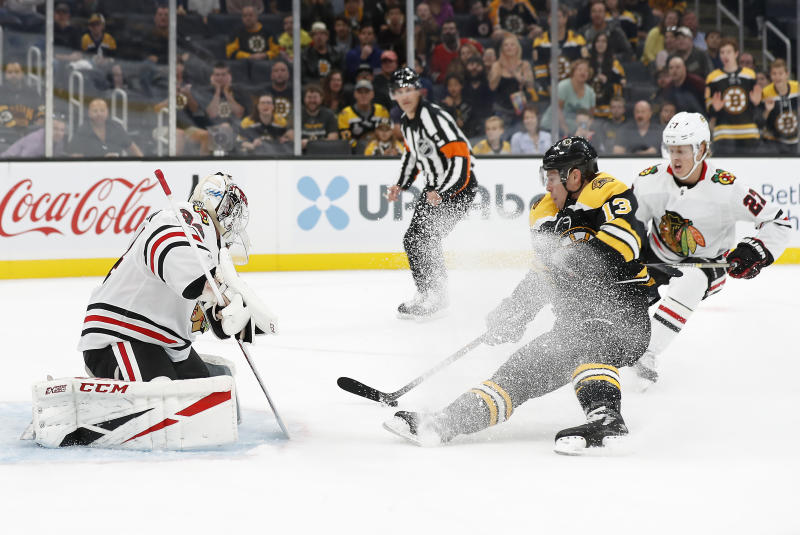 Boston Bruins' Charlie Coyle looses an edge as he moves in to score on Chicago Blackhawks goaltender Kevin Lankinen during the first period of an NHL preseason hockey game Saturday, Sept. 28, 2019, in Boston. (AP Photo/Winslow Townson)