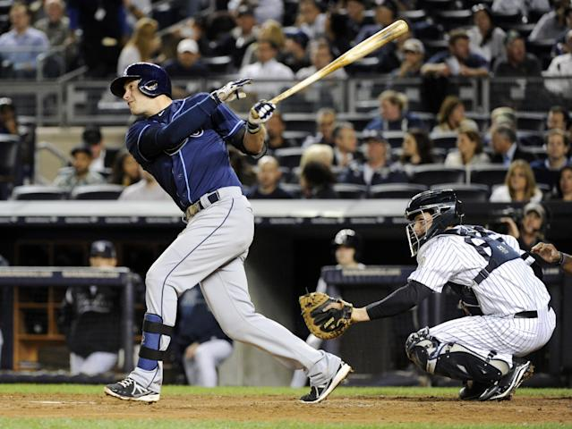 Tampa Bay Rays' Evan Longoria watches his RBI single in front of New York Yankees catcher J.R. Murphy during the fourth inning of a baseball game Thursday, Sept. 26, 2013, at Yankee Stadium in New York. (AP Photo/Bill Kostroun)