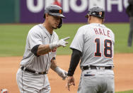Detroit Tigers' Wilson Ramos, left, is congratulated by third base coach Chip Hale, right, after hitting a solo home run during the seventh inning of a baseball game in Cleveland, Sunday, April 11, 2021. (AP Photo/Phil Long)