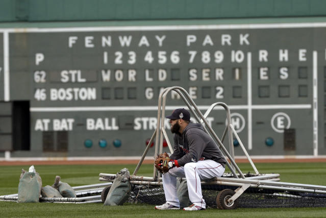 Boston Red Sox's Dustin Pedroia takes a break during batting practice before Game 2 of baseball's World Series against the St. Louis Cardinals Thursday, Oct. 24, 2013, in Boston. (AP Photo/David J. Phillip)