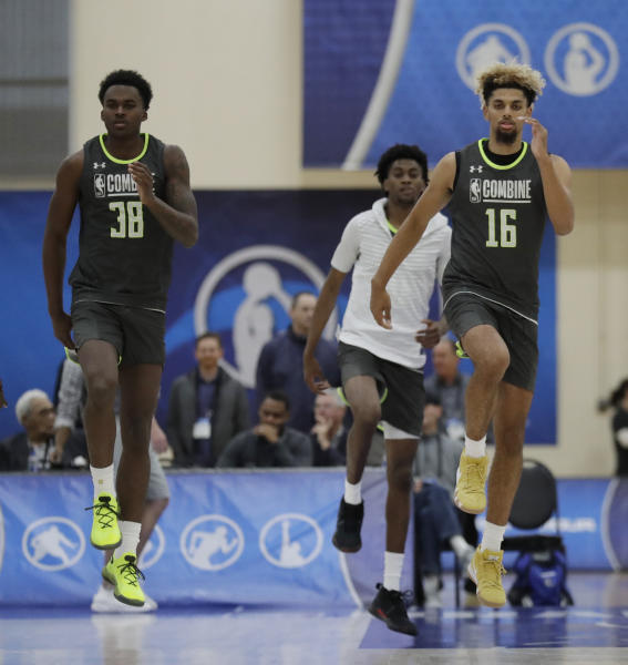 Kris Wilkes, left, and Brian Bowen participate in the second day of the NBA draft basketball combine in Chicago, Friday, May 17, 2019. (AP Photo/Nam Y. Huh)