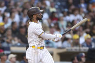 San Diego Padres' Fernando Tatis Jr. watches his solo home run off Washington Nationals starting pitcher Max Scherzer during the fourth inning of a baseball game Thursday, July 8, 2021, in San Diego. (AP Photo/Derrick Tuskan)