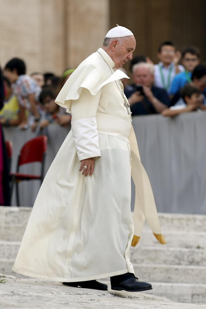 Pope Francis leaves after an audience for the participants of the Convention of the Diocese of Rome in St. Peter's square at the Vatican City, June 14, 2015. REUTERS/Giampiero Sposito