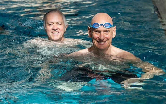 Olympian Duncan Goodhew, right, and The Telegraph's Jim White go swimming on the first day of the reopening of indoor swimming facilities, at the Clissold Leisure Centre, Stoke Newington, London - Geoff Pugh for the Telegraph
