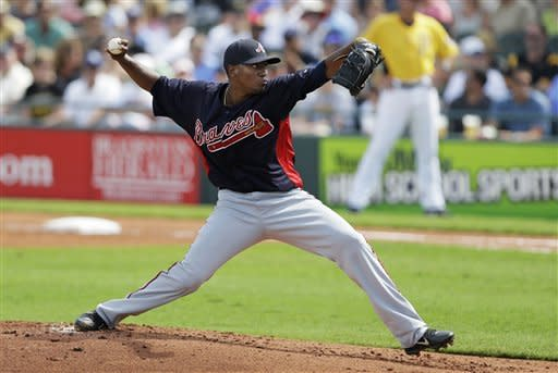 Atlanta Braves starting pitcher Julio Teheran throws during the first inning of a baseball spring training exhibition game against the Pittsburgh Pirates, Sunday, Feb. 24, 2013, in Bradenton, Fla. (AP Photo/Charlie Neibergall)