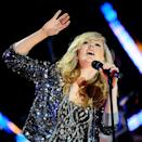 """<div class=""""caption-credit""""> Photo by: Getty Images</div><div class=""""caption-title"""">Performing at the Brit Awards in 2010</div>In one of her earlier performances, Ms. Goulding proved her love for layering textures and prints. A glittering sequin hoodie is an unexpected item to layer over an ikat-print shirt, but her unfussy hair and makeup make it the perfect look for the stage."""