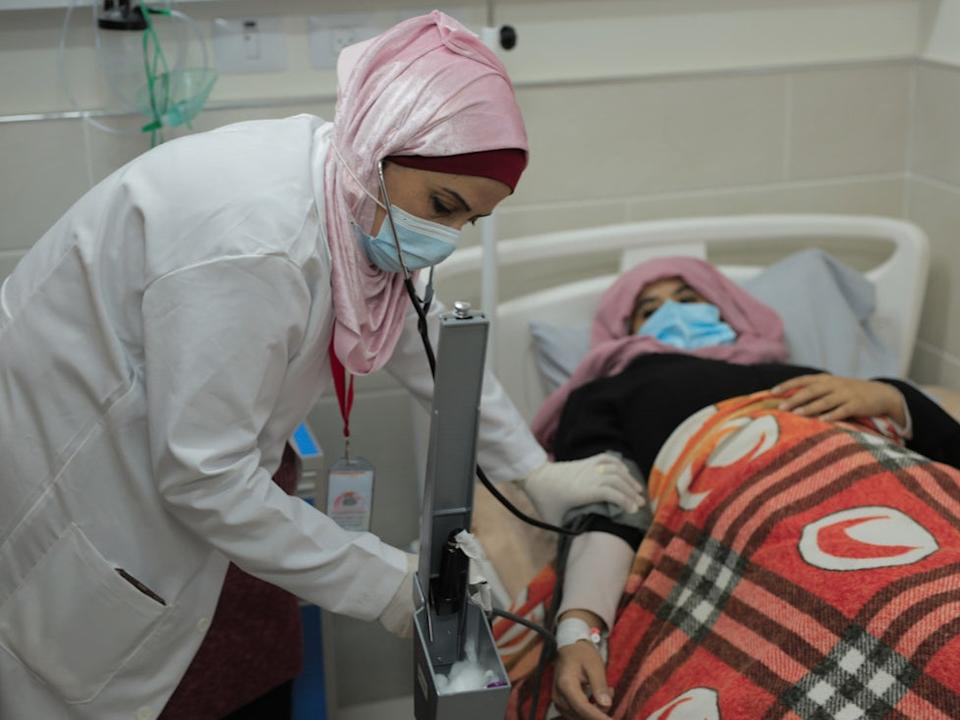 Nurse Heba Shalan from the Gaza Strip says she is often paid less than her full salary; Oxfam says women have been hit harder by the crisis (Marwas Sawaf/Oxfam)