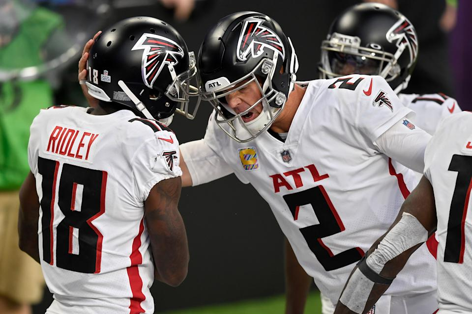 MINNEAPOLIS, MINNESOTA - OCTOBER 18: Calvin Ridley #18 and Matt Ryan #2 of the Atlanta Falcons celebrate after scoring a touchdown in the third quarter against the Minnesota Vikings at U.S. Bank Stadium on October 18, 2020 in Minneapolis, Minnesota. (Photo by Hannah Foslien/Getty Images)