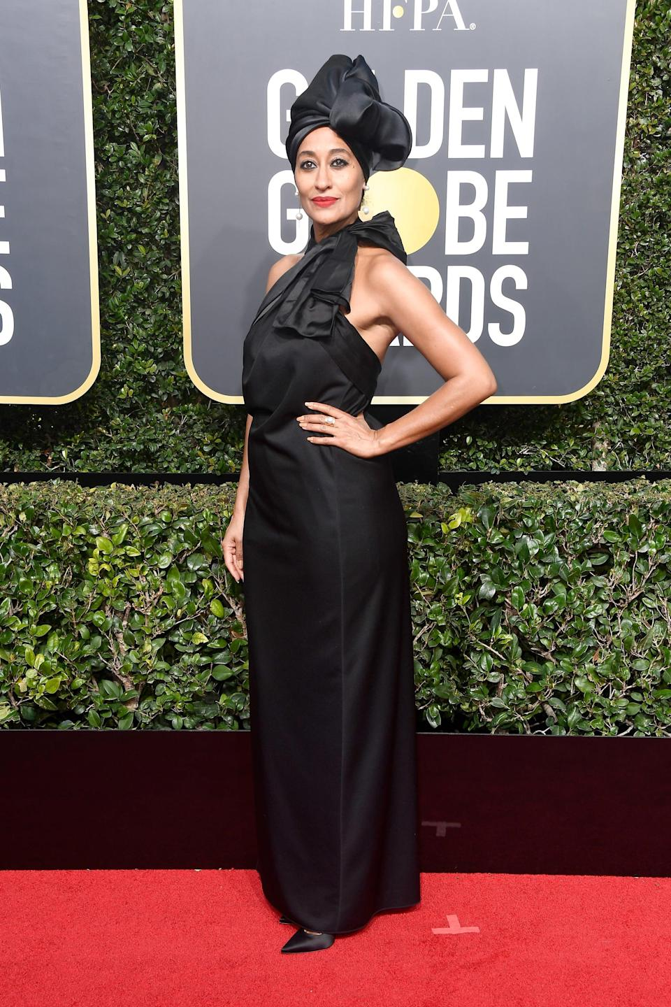 """<p>Wearing a Marc Jacobs Spring 2018 look with a <a href=""""https://www.popsugar.com/beauty/Tracee-Elis-Ross-Golden-Globes-2018-44479565"""" class=""""link rapid-noclick-resp"""" rel=""""nofollow noopener"""" target=""""_blank"""" data-ylk=""""slk:matching headwrap"""">matching headwrap</a> and Irene Neuwirth jewels at the 2018 Globes.</p>"""
