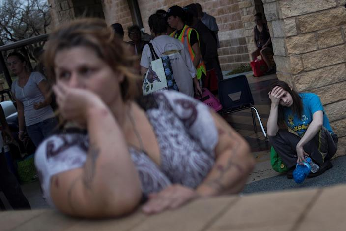 <p>Melanie Starnauld and her 19-year-old son Mathew, who lost their home to Hurricane Harvey, await to be evacuated from Rockport, Texas, Aug. 26, 2017. (Photo: Adrees Latif/Reuters) </p>