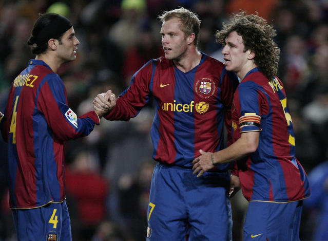 BARCELONA, SPAIN - JANUARY 12: Eidur Gudjohnsen (C) of Barcelona celebrates his opening goal with his teammates Carles Puyol (R) and Rafael Marquez during the La Liga match between Barcelona and Murcia at the Camp Nou Stadium on January 12, 2008 in Barcelona, Spain. (Photo by Jasper Juinen/Getty Images)
