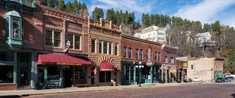 Deadwood, SD. South Dakota collects collects taxes on cigarettes, alcohol and business licenses