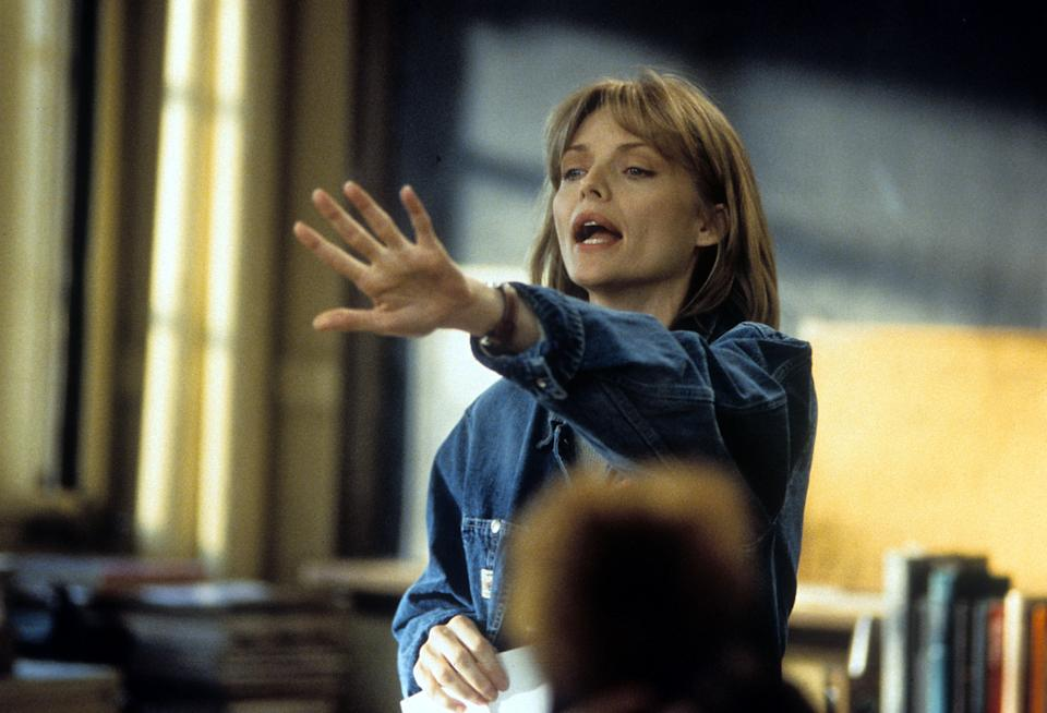 Michelle Pfeiffer teaching a class in a scene from the film 'Dangerous Minds', 1995. (Photo by Hollywood Pictures/Getty Images)