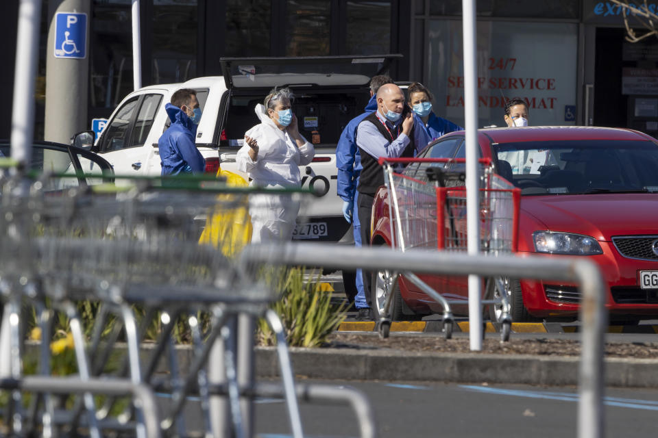 Forensic staff stand outside a supermarket in Auckland, New Zealand on September 4, 2021. Source: AP/Brett Phibbs