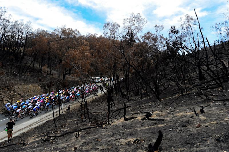 The 2020 Tour Down Under peloton passes through an area of the Adelaide Hills affected by the bushfires on stage 2