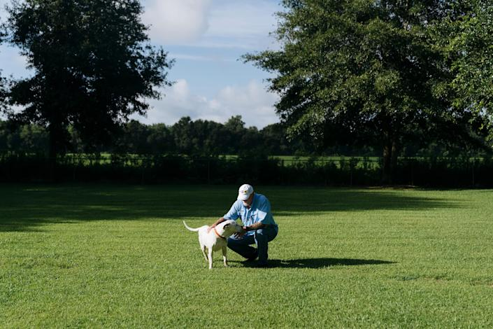 Jeffrey Rust at home in Daphne, Ala., with his son's dog, July 18, 2019. (Annie Flanagan/The New York Times)