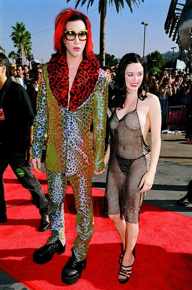 """<b>VMA Moment #6: Rose McGowan's Threadbare Dress (1998)</b>   You might not think that it's possible to upstage Marilyn Manson, but at the 1998 VMAs that is exactly what the goth rocker's girlfriend, Rose McGowan, did. The sultry actress showed up on the red carpet wearing a dress that literally hung in threads, revealing her naked bod and a barely-visible G-string underneath. Her outfit was perhaps even more exciting than Manson's VMA performance of """"The Beautiful People"""" the previous year. Jeff Kravitz/<a href=""""http://filmmagic.com/"""" target=""""new"""">FilmMagic.com</a> - September 10, 1998"""