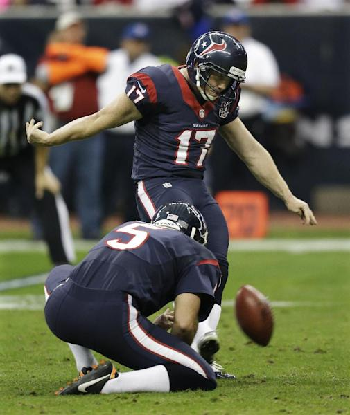 Houston Texans kicker Shayne Graham (17) kicks a field goal as Donnie Jones holds against the Cincinnati Bengals during the second quarter of an NFL wild card playoff football game Saturday, Jan. 5, 2013, in Houston. (AP Photo/Eric Gay)