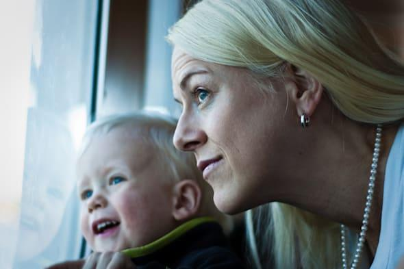 Mother and son looking out.