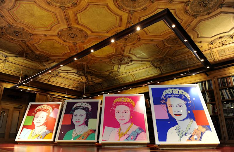 """Four Andy Warhol portraits of Queen Elizabeth II are seen in Windsor Castle, Windsor, England, Monday Sept. 24, 2012, and will form part of the """"Portraits of a Monarch"""" exhibit starting in November at Windsor Castle until June 2013. The colorful screenprints are based on a formal photograph of the queen wearing a tiara and necklace that was used during her Silver Jubilee celebrations in 1977. (AP Photo/PA, Andrew Matthews) UNITED KINGDOM OUT NO SALES NO ARCHIVE"""