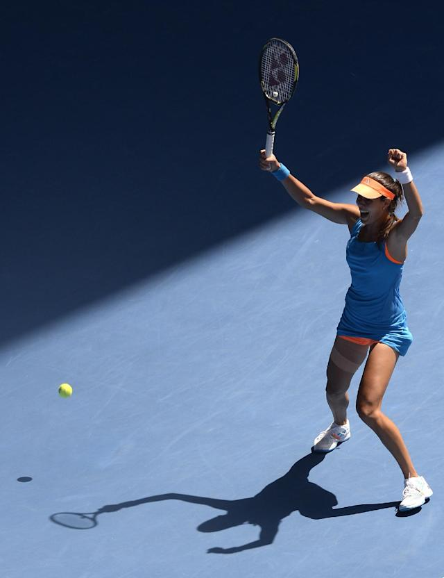 Ana Ivanovic of Serbia celebrates her win over Serena Williams of the U.S. in their fourth round match at the Australian Open tennis championship in Melbourne, Australia, Sunday, Jan. 19, 2014.(AP Photo/Andrew Brownbill)