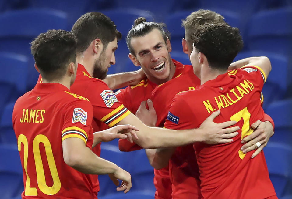 Wales' Gareth Bale, center, and teammates celebrate their first goal scored by David Brooks, 2nd right, during the UEFA Nations League soccer match at Cardiff City Stadium, Cardiff, Wales, Sunday Nov. 15, 2020. (Nick Potts/PA via AP)