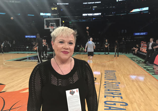 <p> Holly Rowe stands on the court at Madison Square Garden in New York before a WNBA basketball game between the New York Liberty and the Minnesota Lynx, Thursday, May 18, 2017. Rowe was back on the sidelines for her first WNBA game of the season Thursday night. Dashing for interviews with coaches between quarters or talking to NBA Commissioner Adam Silver, who attend the game, Rowe was in her element. It was a welcome reprieve for her from her bout with melanoma which has recurred and spread. Earlier in the day, ESPN announced that it had re-signed Rowe to a multiyear contract extension. She was worried she be one of the people ESPN let go last month. (AP Photo/Doug Feinberg) </p>