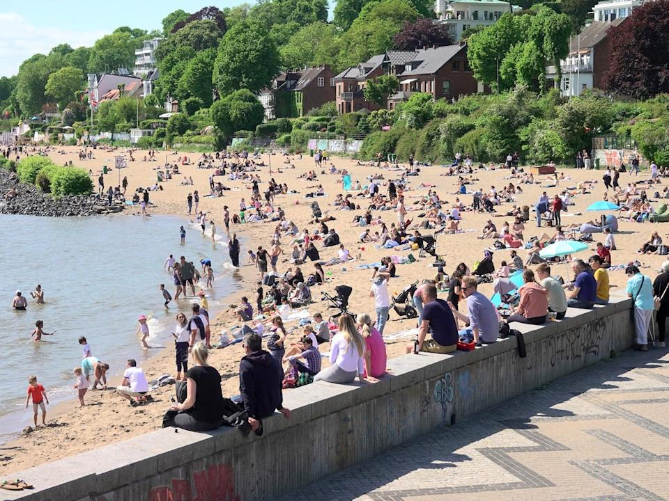 People spend Father's Day on the Elbe beach in Övelgönne, Hamburg, on May 21, 2020.