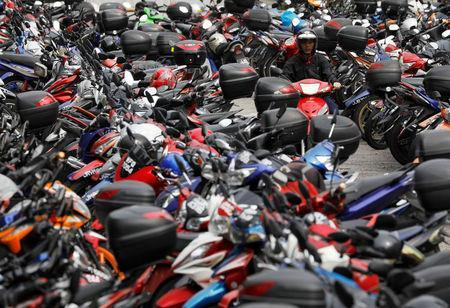 A motorcyclist looks for a lot at a carpark in Malaysia's southern city of Johor Bahru April 26, 2017. REUTERS/Edgar Su