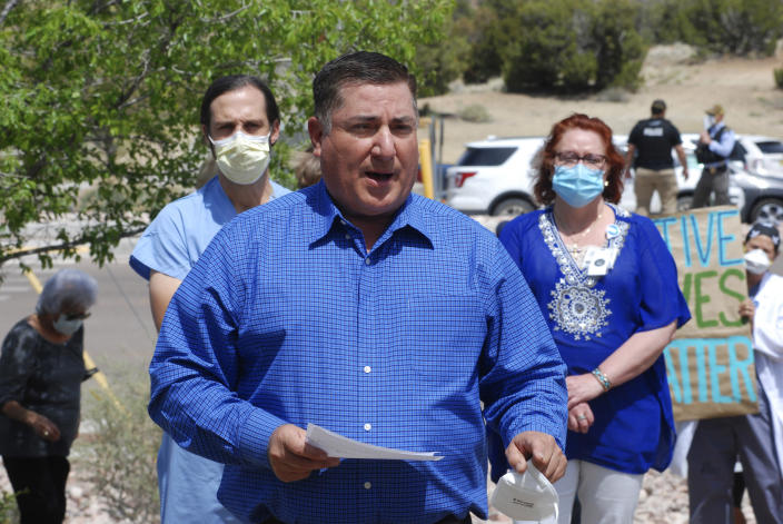 In this May 8, 2020, photo, New Mexico state Sen. George Munoz, D-Gallup, joins medical staff from Rehoboth McKinley Christian Hospital in a protest over working conditions and depleted staff in Gallup, N.M. (AP Photo/Morgan Lee)