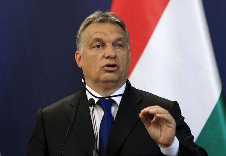 Orban attends a news conference in Budapest