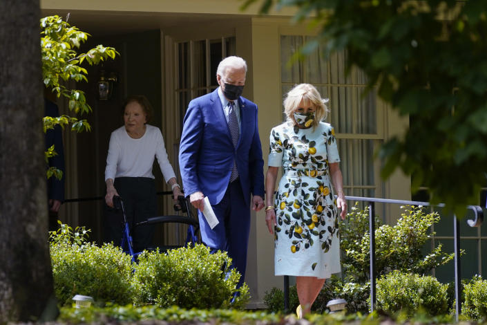 President Joe Biden and first lady Jill Biden walk with former first lady Rosalynn Carter as they leave the home of former President Jimmy Carter during a trip to mark Biden's 100th day in office, Thursday, April 29, 2021, in Plains, Ga. (AP Photo/Evan Vucci)