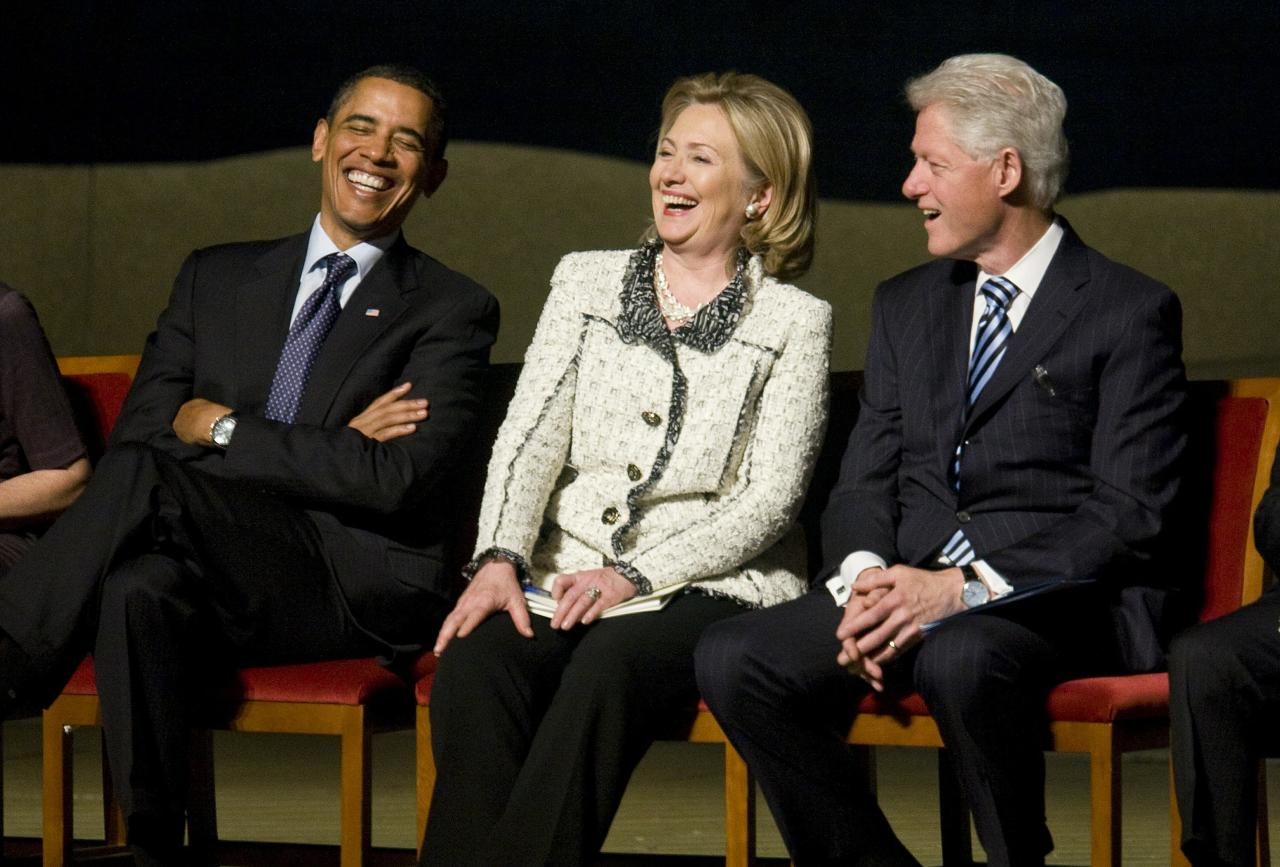 WASHINGTON, DC - JANUARY 14:  (AFP OUT)  (L - R) U.S. President Barack Obama, U.S. Secretary of State Hillary Clinton, and Former U.S. President Bill Clinton attend a memorial service for Ambassador Richard Holbrooke on January 14, 2011 at the Kennedy Center in Washington, D.C.  Holbrooke passed away in December after undergoing heart surgery to repair a tear in his aorta.  (Photo by Kristoffer Tripplaar-Pool/Getty Images)