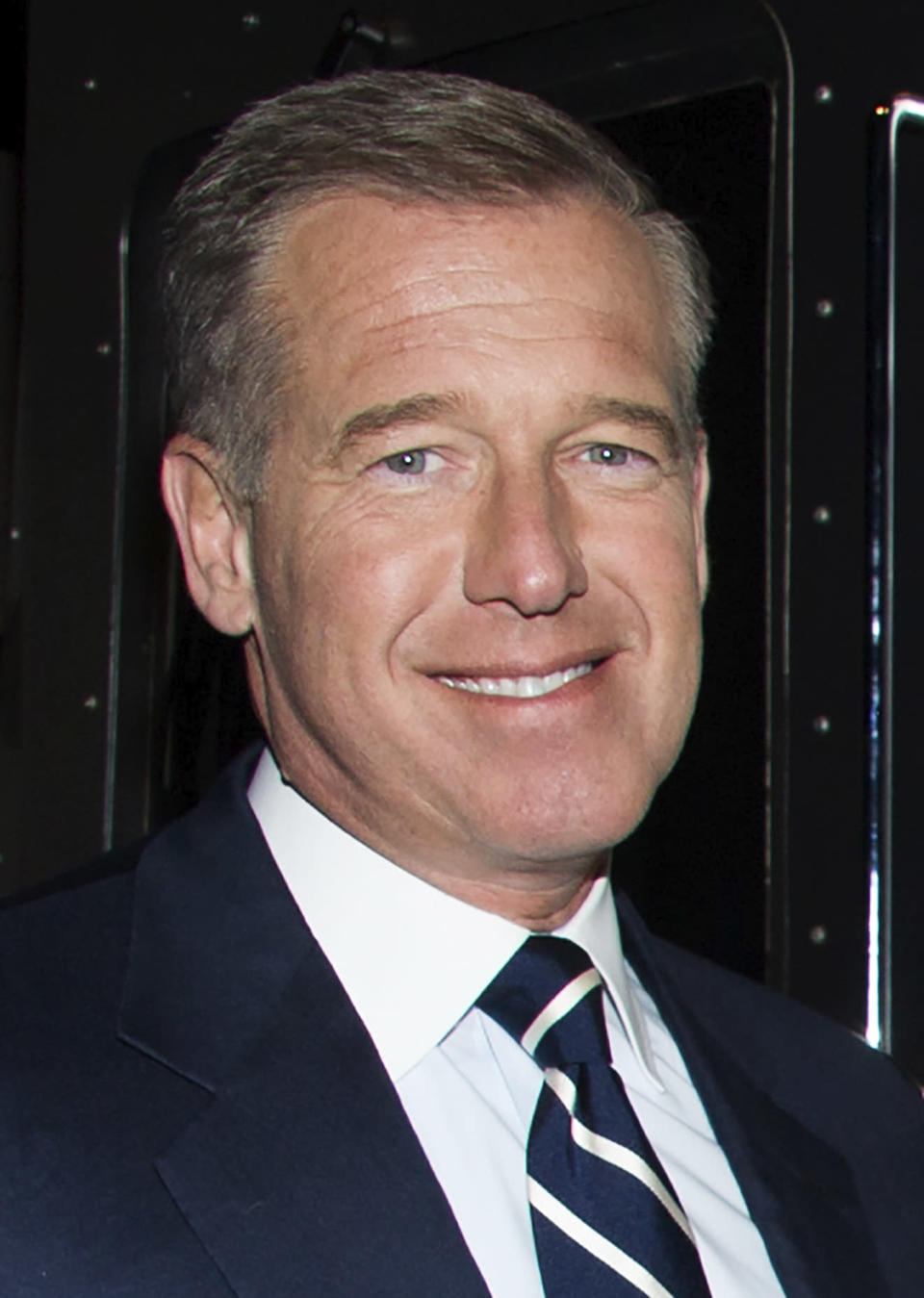 """FILE - Brian Williams attends the after party following the premiere of HBO's """"Girls"""" third season in New York on Jan. 6, 2014. A new podcast based on Joe Garner's 1998 book, """"We Interrupt This Broadcast,"""" narrated by Williams, will be available on July 20. Episodes in the first season explore the Sept. 11, 2001 attacks, John F. Kennedy's assassination and the moon landing. (Photo by Charles Sykes/Invision/AP, File)"""