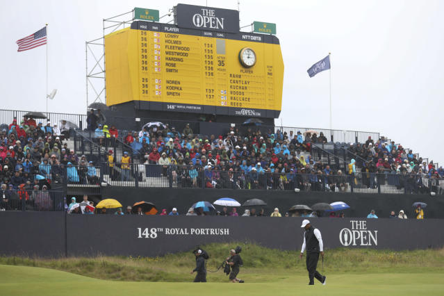 Tiger Woods of the United States walks on the 18th green as he competes his second round of the British Open Golf Championships at Royal Portrush in Northern Ireland, Friday, July 19, 2019.(AP Photo/Peter Morrison)