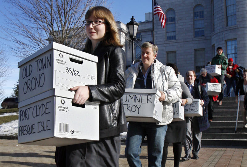 FILE - In this Thursday, Jan. 26, 2012 file photo, Whitney Gifford, of Bucksport, Maine, leads a group of gay marriage supporters carrying signed petitions to the Secretary of State's office in Augusta, Maine. Poll after poll shows public support for same-sex marriage steadily increasing, to the point where it's now a majority viewpoint. Yet in all 32 states where gay marriage has been on the ballot, voters have rejected it. It's possible the streak could end in November 2012, when Maine, Maryland, Minnesota and Washington state are likely to have closely contested gay marriage measures on their ballots. For now, however, there remains a gap between the national polling results and the way states have voted. (AP Photo/Robert F. Bukaty, File)
