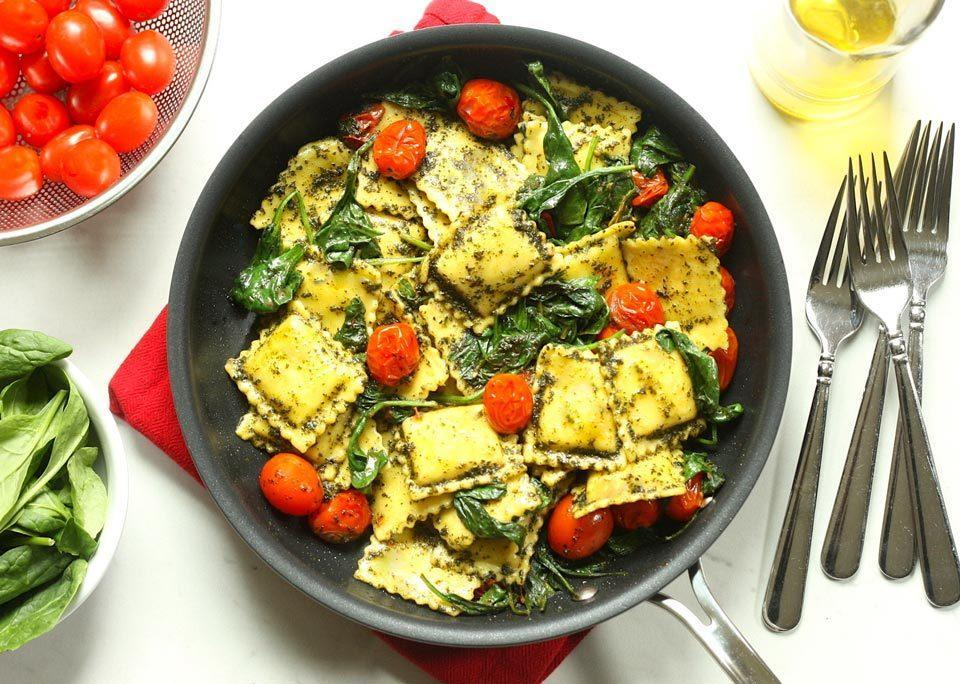 <p>Looking for a new way to turn a bag of frozen cheese ravioli into a satisfying and healthy dinner? This easy pasta recipe calls for just five ingredients but is loaded with fresh flavors. By using grape tomatoes, prewashed spinach and prepared pesto, we eliminate all prep work, making this 15-minute Caprese-inspired ravioli the ideal weeknight meal.</p>