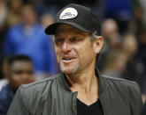 FILE - In this March 3, 2017, file photo, former cyclist Lance Armstrong stands on the court after an NBA basketball game between the Cleveland Cavaliers and Atlanta Hawks in Atlanta. The Associated Press asked eight of the greatest current and former champions, including Armstrong, from seven different sports to find out what impressed them most about Tom Brady. (AP Photo/Brett Davis, File)
