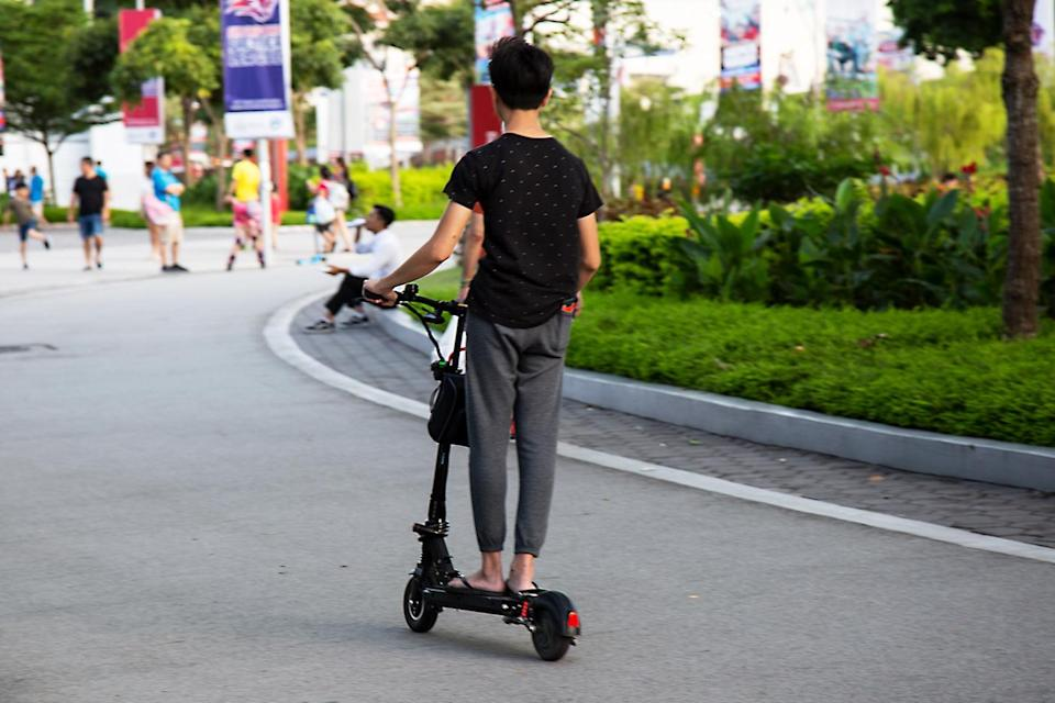 An e-scooter rider seen outside Kallang Wave Mall. (Yahoo News Singapore file photo)