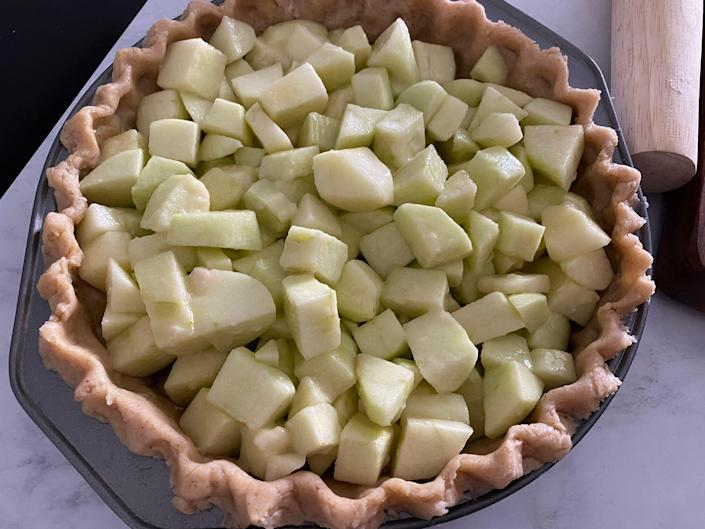 A crust filled with apple-pie filling.