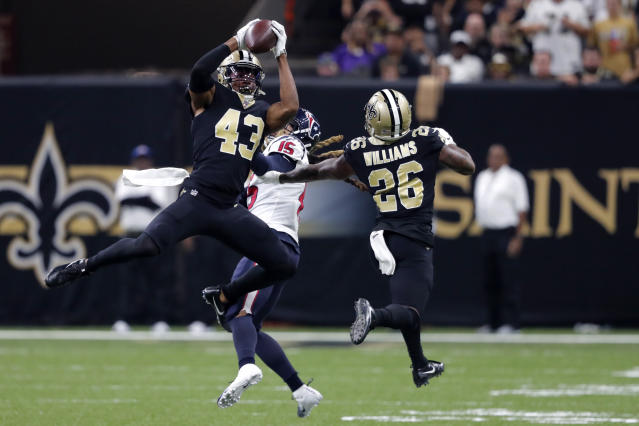 New Orleans Saints free safety Marcus Williams (43) intercepts a pass intended for Houston Texans wide receiver Will Fuller (15) in the second half of an NFL football game in New Orleans, Monday, Sept. 9, 2019. (AP Photo/Bill Feig)