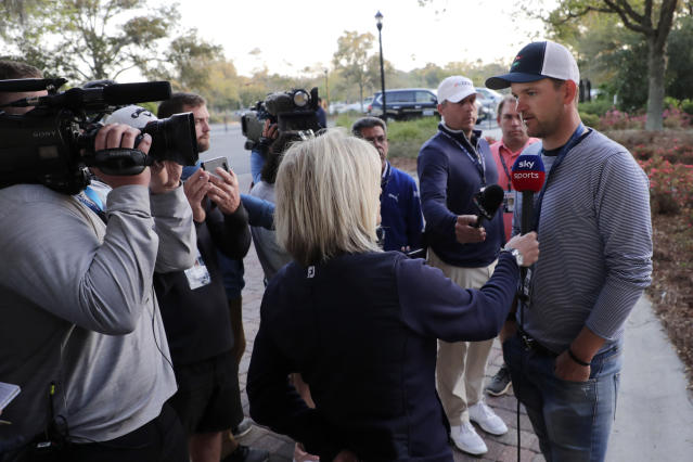 Bernd Wiesberger of Austria, right, is interviewed after the PGA tour canceled the rest of The Players Championship golf tournament as a result of the coronavirus pandemic, Friday, March 13, 2020, in Ponte Vedra Beach, Fla. (AP Photo/Lynne Sladky)