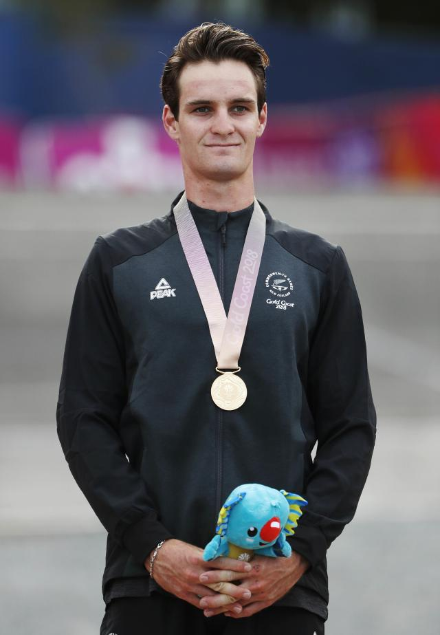Cycling Cross-Country - Gold Coast 2018 Commonwealth Games - Mountain Bike - Men's Cross-Country - Nerang Mountain Bike Trails - Gold Coast, Australia - April 12, 2018. Samuel Gaze of New Zealand poses with his gold medal. REUTERS/Paul Childs