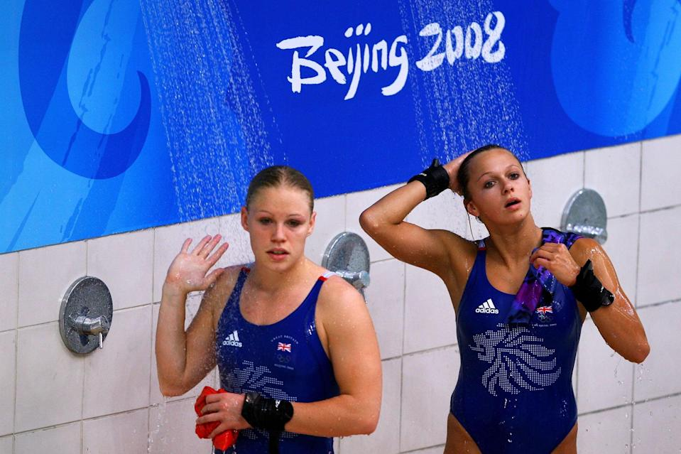BEIJING - AUGUST 12:  Tonia Couch (R) and Stacie Powell of Great Britain shower in the Women's Synchronised 10m Platform Final held at the National Aquatics Center during day 4 of the Beijing 2008 Olympic Games on August 12, 2008 in Beijing, China.  (Photo by Julian Finney/Getty Images)
