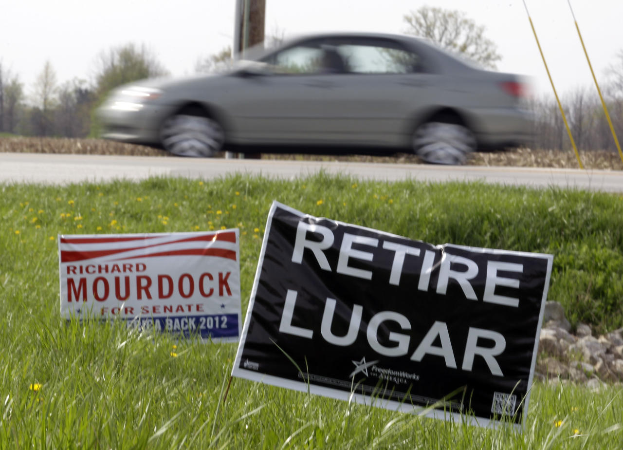 "A yard signs calling for voters to ""retire"" Sen. Richard Lugar stands along the road in New Palestine, Ind., Friday, March 30, 2012. Lugar, running for his seventh term in the U.S. Senate, is facing one of his toughest election battles in the Republican primary against state Treasurer Richard Mourdock. Lugar will switch his voter registration to his family farm in resolving a dispute with local election officials who ruled that he couldn't vote using the address of an Indianapolis home he sold in 1977. (AP Photo/Michael Conroy)"