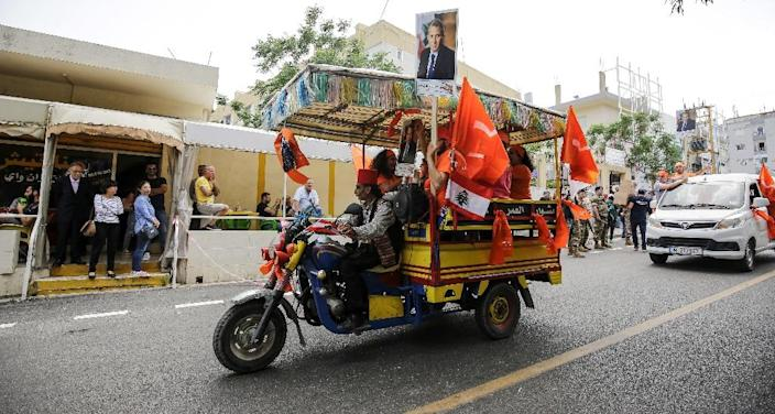 A man drives a motorcycle cart transporting supporters of Lebanon's foreign minister in the Lebanese coastal city of Batroun north of the capital Beirut as the country holds its first parliamentary election in nine years on May 6, 2018 (AFP Photo/IBRAHIM CHALHOUB)