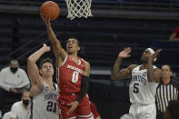 Wisconsin's D'Mitrik Trice (0) drives to the basket between Penn State's John Harrar (21) and Jamari Wheeler (5) during the second half of an NCAA college basketball game, Saturday, Jan. 30, 2021, in State College, Pa. (AP Photo/Gary M. Baranec)